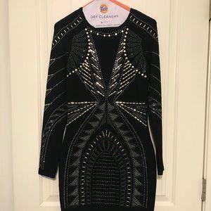 Black long sleeve mini dress with bead detail